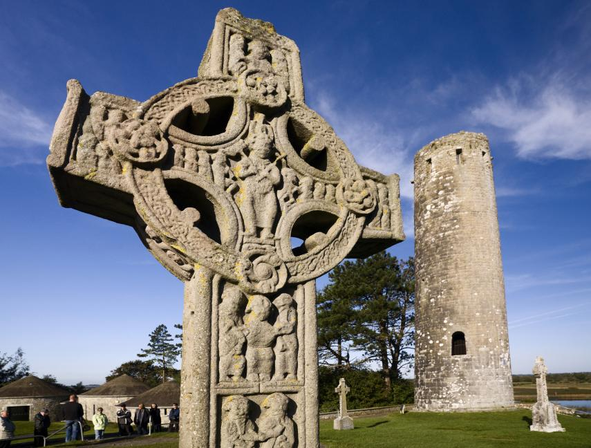 A carved stone Celtic cross in the ruins of Clonmacnoise, Ireland