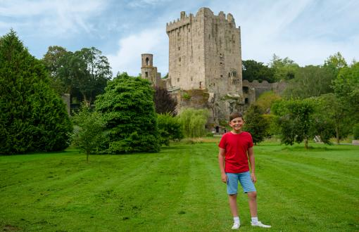 Boy in front of Blarney Castle