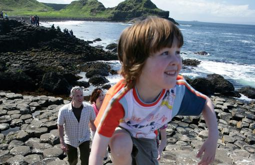 Child climbing along Giant's Causeway